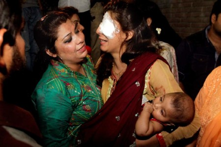 A mother injured in the bomb blast is comforted at a local hospital in Lahore